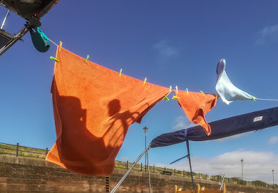 Photo of washing drying on a line on Ravensdale's aft deck