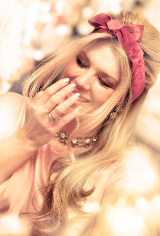 laughing, bit hair, velvet bow, vintage jewels