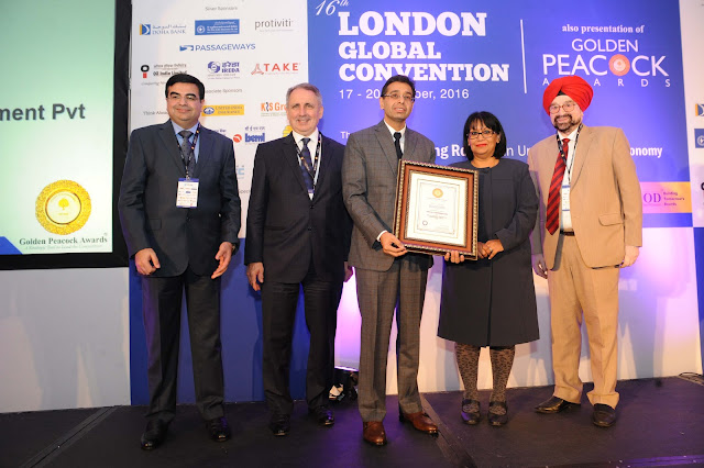 Mr. Sandeep Sabharwal in middle recieving Golden peacock award for Innovation Management