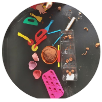 chocolate playdough tuff tray with chocolate moulds and playdough tools