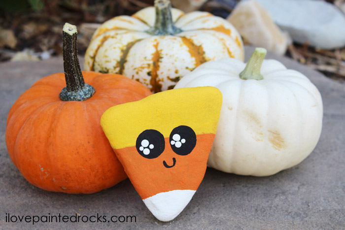 Candy corn is the cutest of all the Autumn treats, paint it on a rock for holiday decorations.