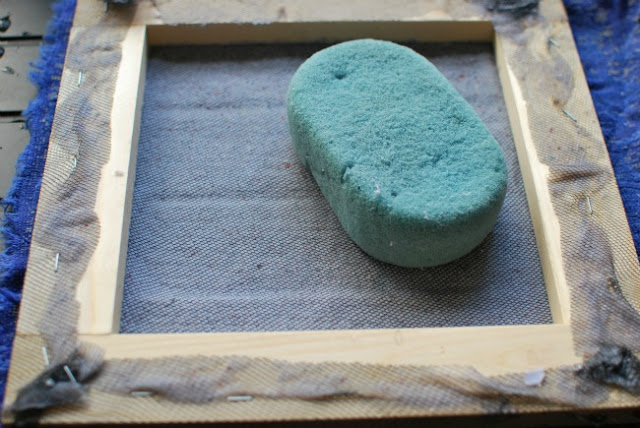 frame turned over and sponge to soak the water