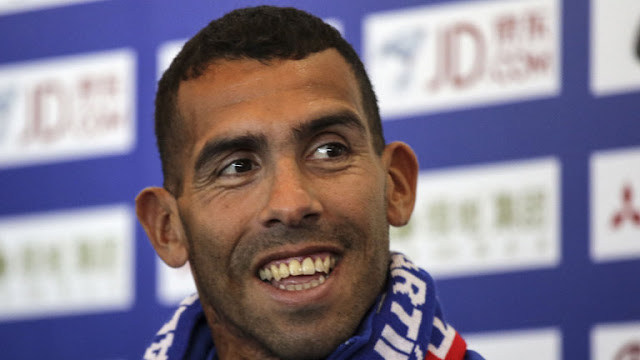 Carlos Tevez smile when he arrived in Shanghai, China. PHOTO | SkySports