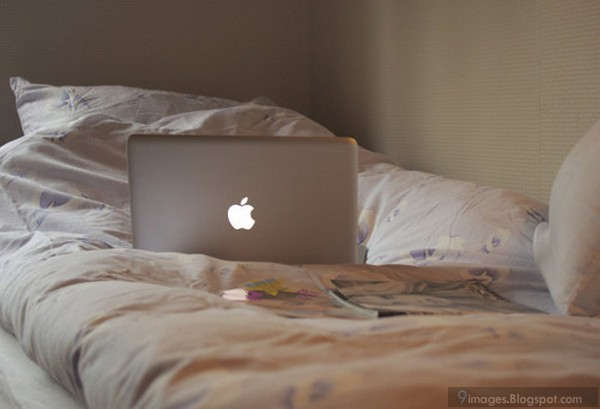 White Apple Laptop On Bed Photography