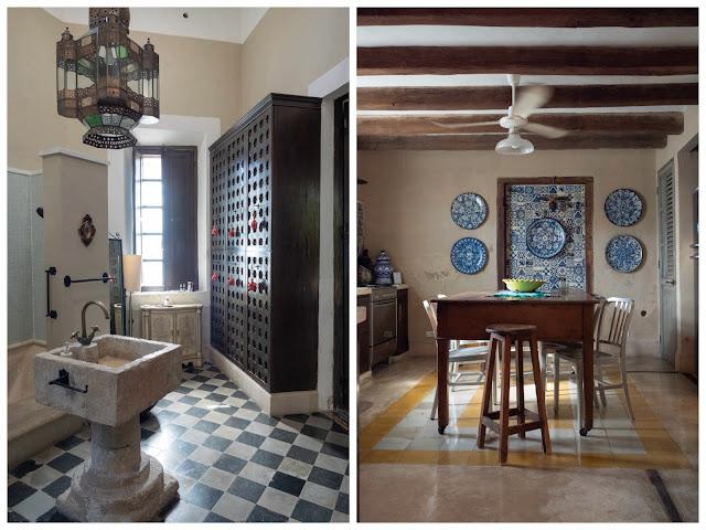 Vista de un baño con una pila de piedra y suelo de ajedrez; y cocina con mesa de madera antigua y pared de azulejos azules