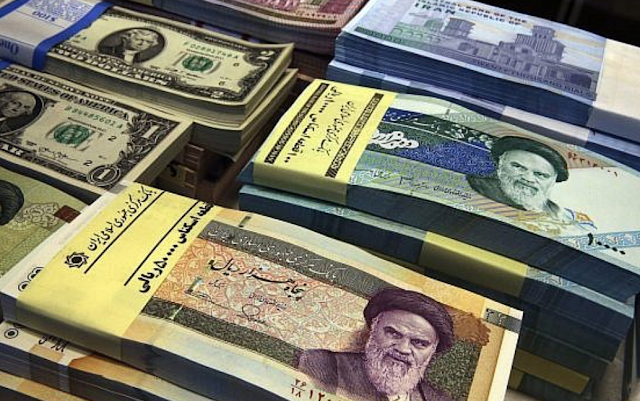 Iran's currency hit a record low on Sunday of 100,000 rials to the dollar amid a deepening economic crisis and the imminent return of full US sanctions.