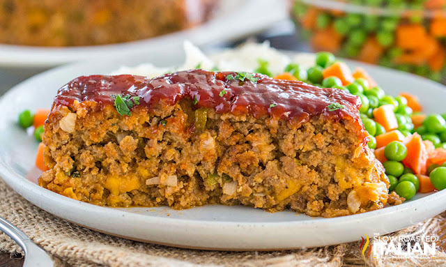 Served meatloaf on a plate with veggies