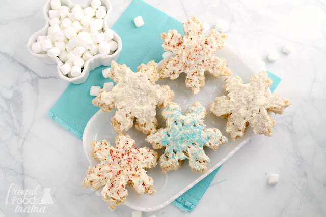Classic Rice Krispies Treats get a winter wonderland makeover just in time for the holidays with these Sparkling Snowflake Rice Krispies Treats.
