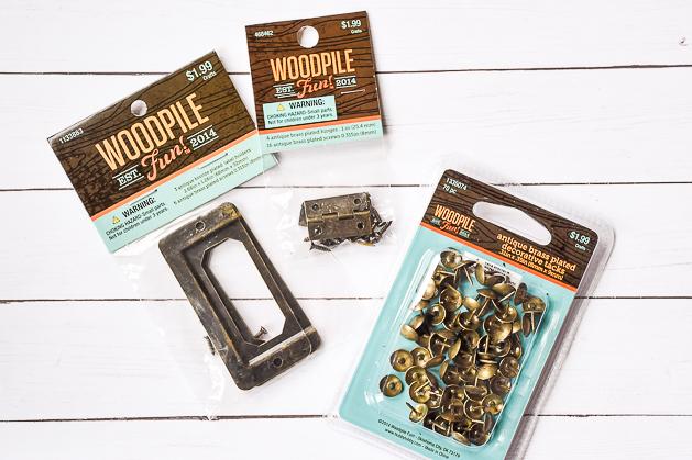 woodpile, metal label holders, metal tacks