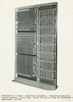 A black and white photograph of a relay rack.