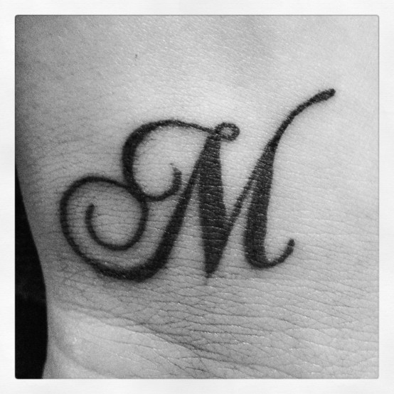 Letter M tattoos design images -