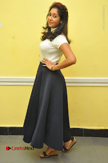 Telugu Actress Sindhu Affan Latest Pos in Black Skirt at Www.Meena Bazaar Movie Opening  0045.JPG