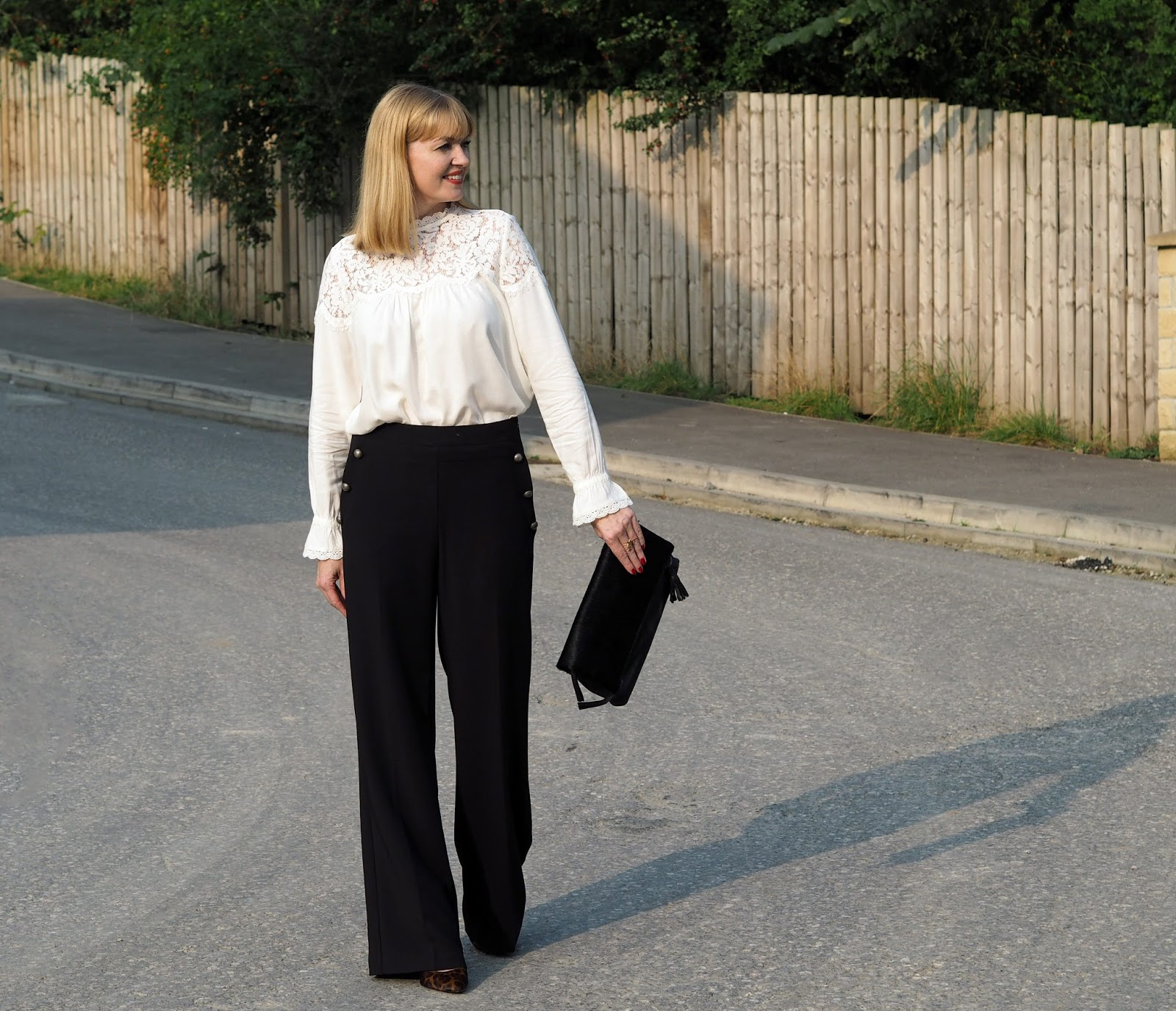 Wide legged trousers and strappy leopard print heels
