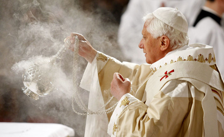 Pope Benedict XVI circles the altar with incense during Mass at St. Patrick's Cathedral in New York on Saturday.