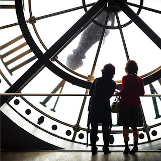 Children by clock face