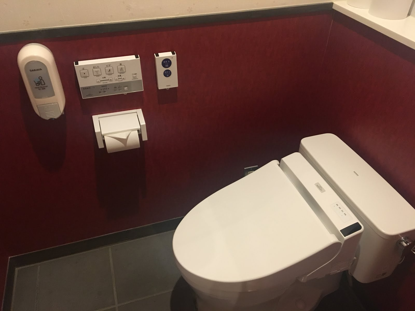 modern japanese toilet with sanitizing wipes, buttons to wash and control heat, pressure.  Also buttons to play music to drown out bathroom sounds. Super cool.
