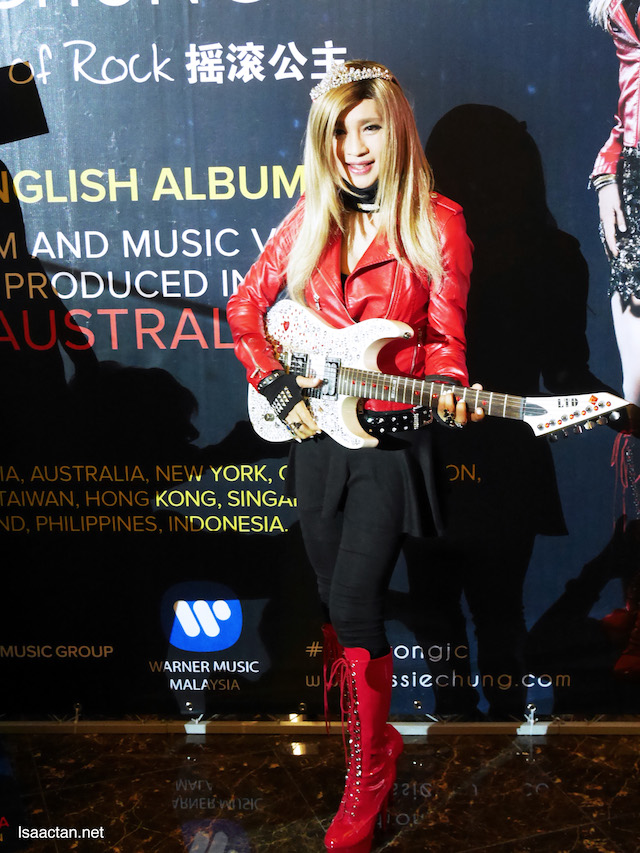 "Jessie Chung, ""Princess Of Rock"" with her diamond-studded electric guitar and beautiful crown"