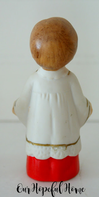 Vintage porcelain choir boy in robe with candles made in Japan.