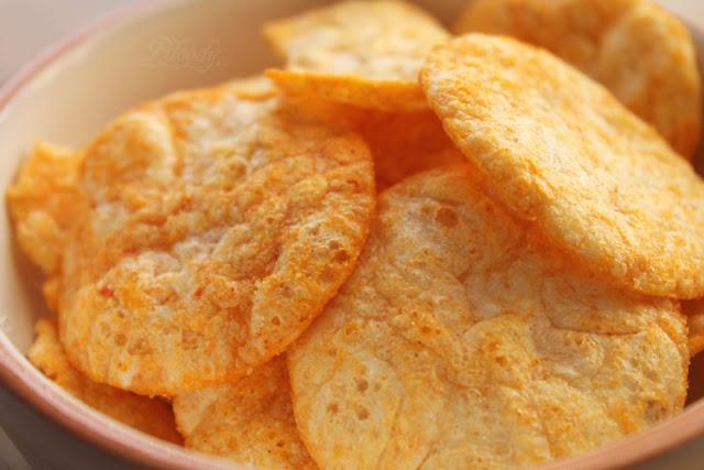 Die Chips der FunPop's Paprika mit rötlichem Gewürz.
