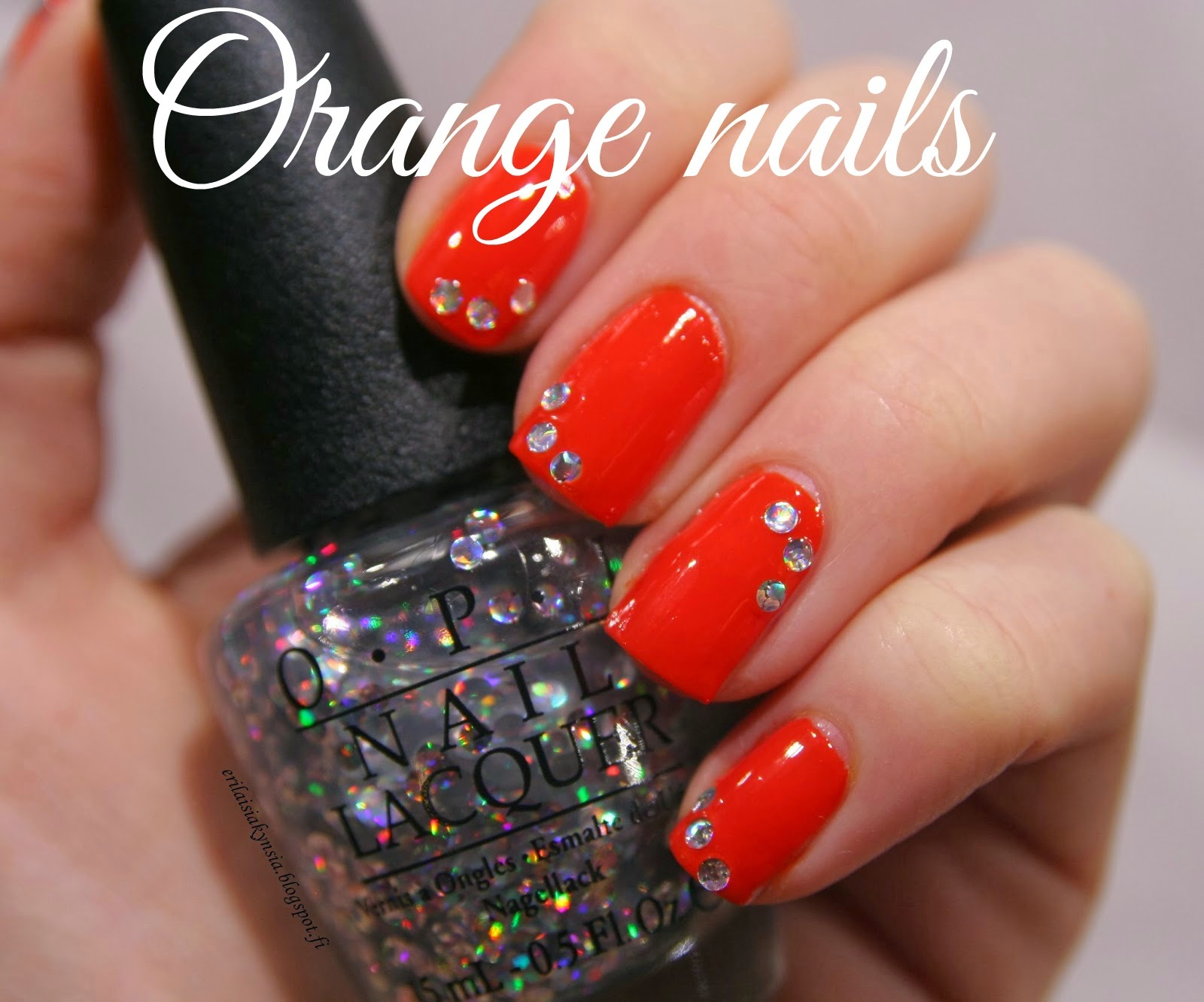 http://erilaisiakynsia.blogspot.fi/2014/02/148-31dnc-2-orange-nails.html
