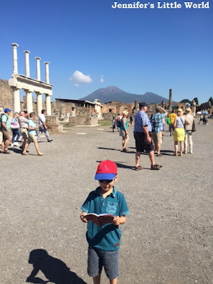 Child studying map at Pompeii