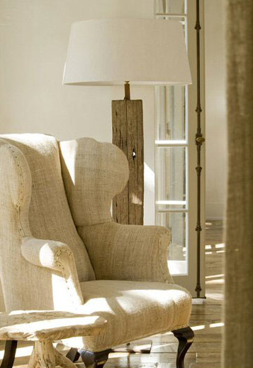 Belgian linen upholstery on a wing chair in a French country space designed by Pamela Pierce.