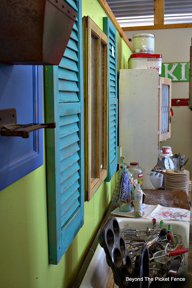 bright colors, shutters, old window, decor, Beyond The Picket Fence, http://bec4-beyondthepicketfence.blogspot.com/2015/02/5-decorating-lessons-from-store.html