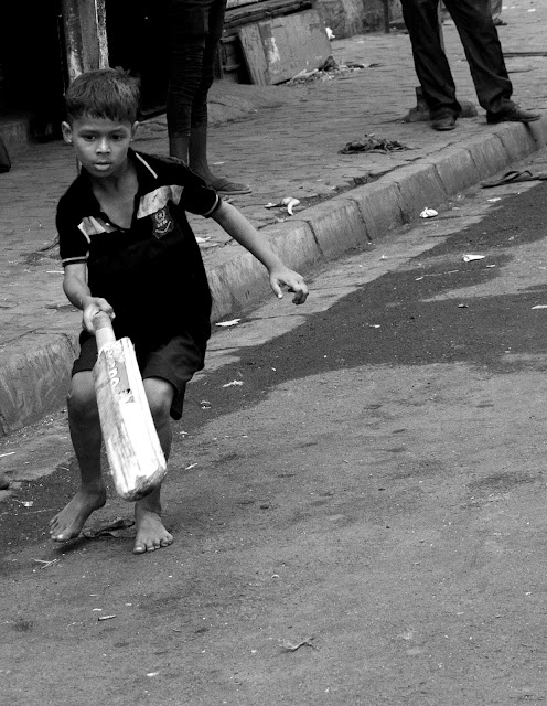 playtime, boy, cricket, street, street photo, street photography, mumbai, india, monochrome, black and white