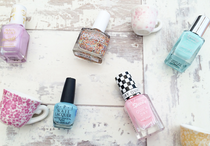 Pastel nail vanishes on a distressed white background with dainty teacups