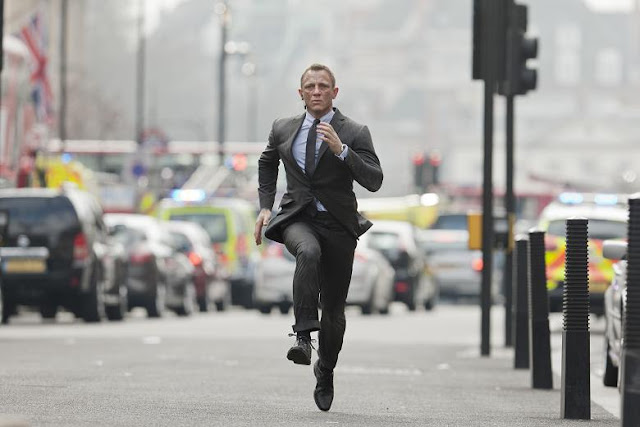 Daniel Craig as James Bond running down a street in Skyfall movieloversreviews.filminspector.com