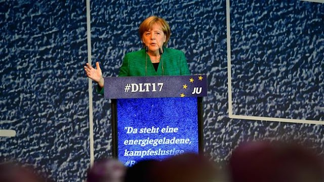 German Chancellor Angela Merkel pushes for trilateral 'Jamaica' coalition