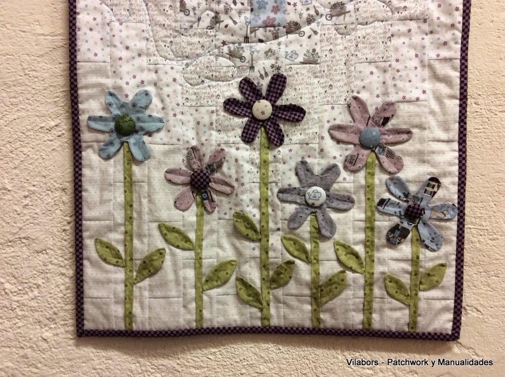Detalle del Tapete primaveral de pared con la colección Lynette Anderson - Patchwork Vilabors