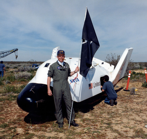 NASA X-38 flight test engineer Mike Fossum is all smiles following the first free flight of the first X-38 prototype in March 1998. Two months after this photo was taken Fossum was selected as an astronaut. Photo Credit: Ed Hengeveld