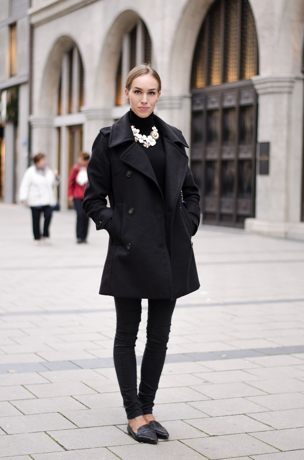 kristjaana mere all black fall outfit with statement necklace