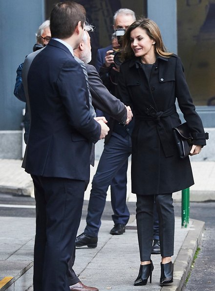 Queen Letizia wore Hugo BossJadela Stretch Virgin Wool Asymmetrical Blazer, ankle boots and carried clutch