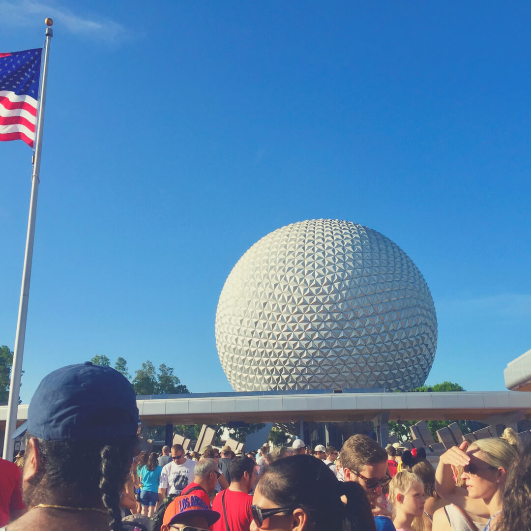 The entrance to Epcot, Walt Disney World is crowded with people