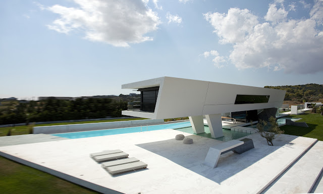 Picture of modern home with large terrace and swimming pool