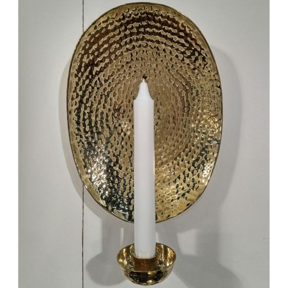 Oval lampett i mässing att hänga på väggen.
