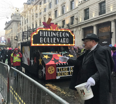 Pic of charity bucket bearer and vehicle behind in Regent Street, London