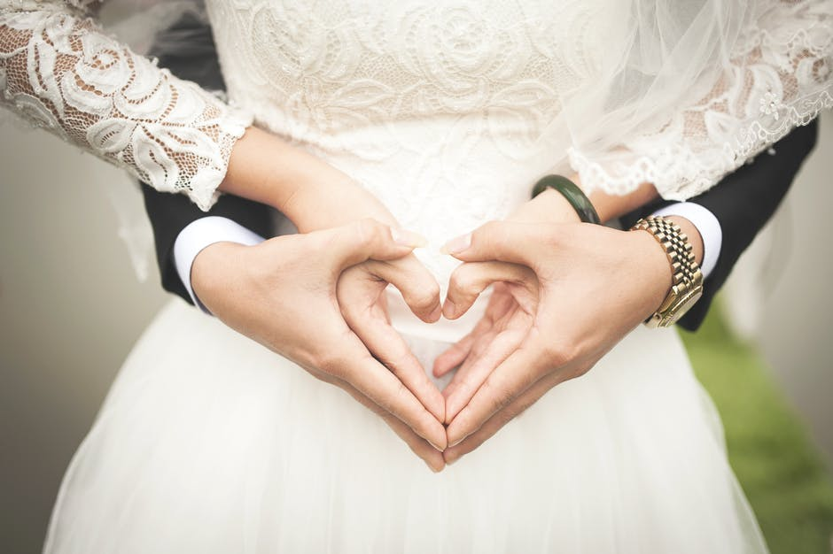 wedding day couple holding heart hands