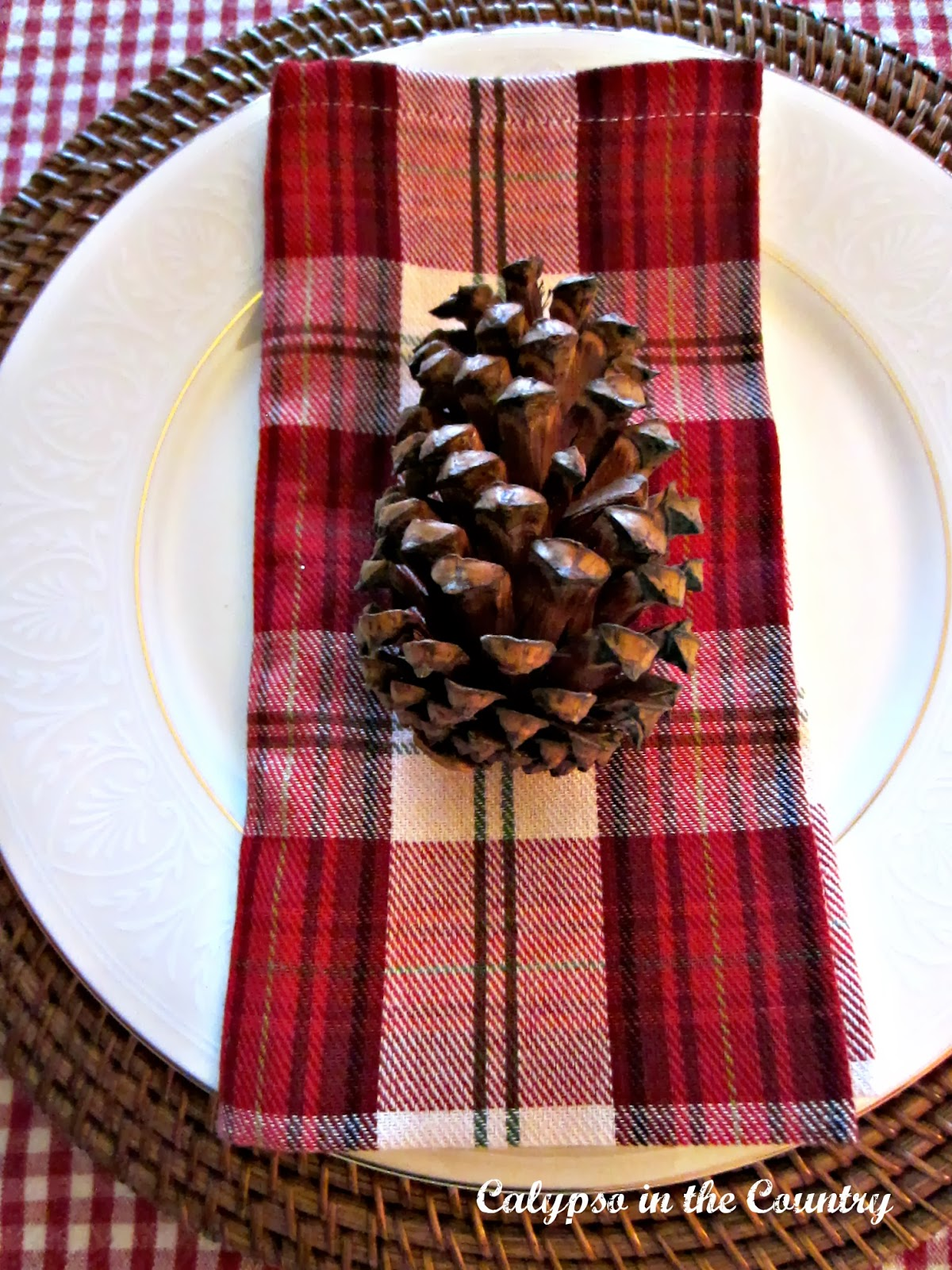 Christmas Table with Pine Cones and Plaid Napkins