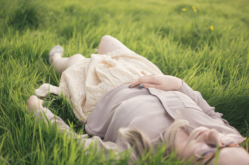 How To Holiday On A Budget girl laying in the grass