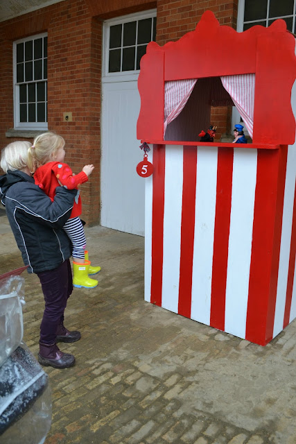 Tin Box Tot enjoying the Punch and Judy show at Mottisfont Abbey