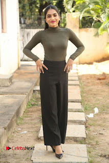 Tollywood Actress Punarnavi Bhupalam Latest Po Gallery in Black Trouser Pant at Pittagoda Movie Interview  0141.JPG