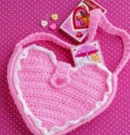 http://translate.googleusercontent.com/translate_c?depth=1&hl=es&rurl=translate.google.es&sl=en&tl=es&u=http://www.countrywomanmagazine.com/project/heart-shaped-crochet-purse-pattern/&usg=ALkJrhiMpWW_WoKXN-GTa80QzWYIC1FVVQ