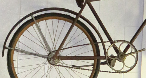 Old Bicycle Wheel on Wall Background