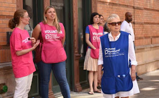 Abortion escorts in front of Planned Parenthood's Margaret Sanger Clinic on Bleecker St., New York, Aug. 22, 2015