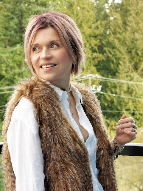 white shirt with a long, faux-fur vest