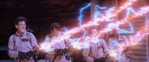 Harold Ramis, Dan Aykroyd, Bill Murray, and  Ernie Hudson in 'Ghostbusters' firing red and blue streams of energy from their proton-pack guns