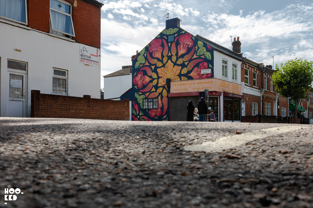 Street view of the full mural painted by US artist Beau Stanton in Walthamstow, London